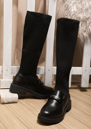 POWER AND PRACTICALITY BLACK CALF-LENGTH BOOTS