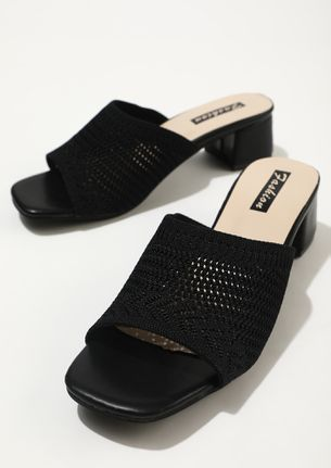 WITH A FEMININE TOUCH BLACK HEELED MULES