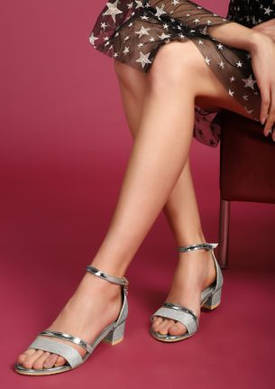 WALKING WITH A BLISS SILVER HEELED SANDALS