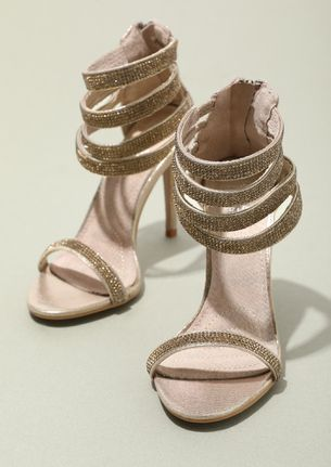 A STRAP OF GOLD HEELED SANDALS