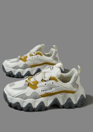 ALL PUMPED UP TO RUN MUSTARD TRAINERS