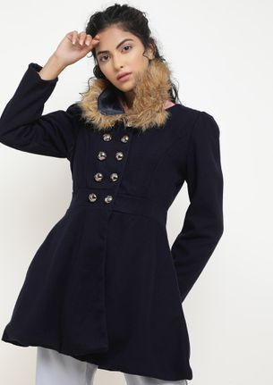 TWIRLING AROUND IN BLUE DOUBLE BREASTED COAT