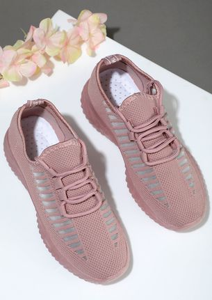 On full time off-duty PINK TRAINERS