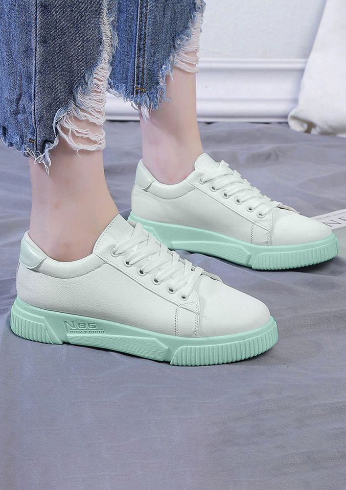 A BLOCK OF COLOUR GREEN TRAINERS