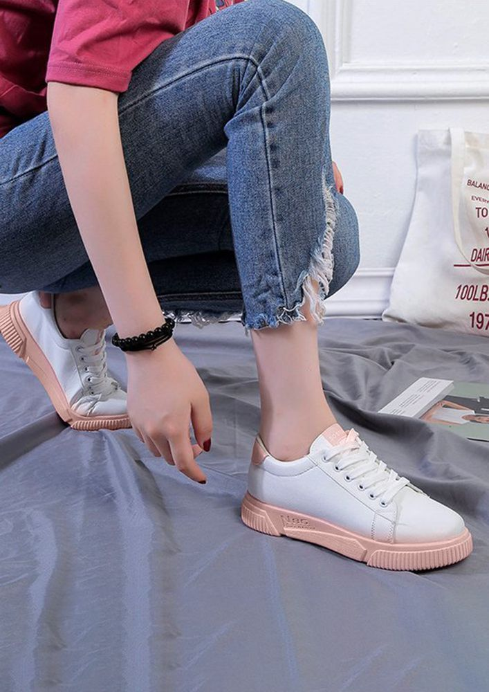 A BLOCK OF COLOUR PINK TRAINERS