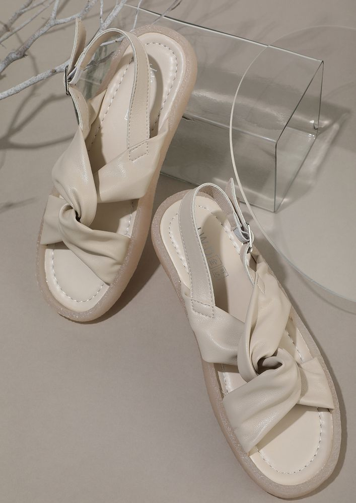 TWIST FOR THE WIN BEIGE FLAT SANDALS