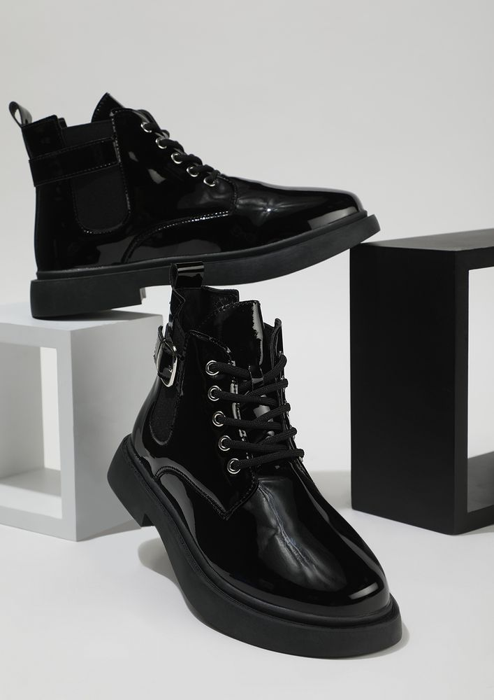 ENERGY OVERFLOW PATENT BLACK ANKLE BOOTS