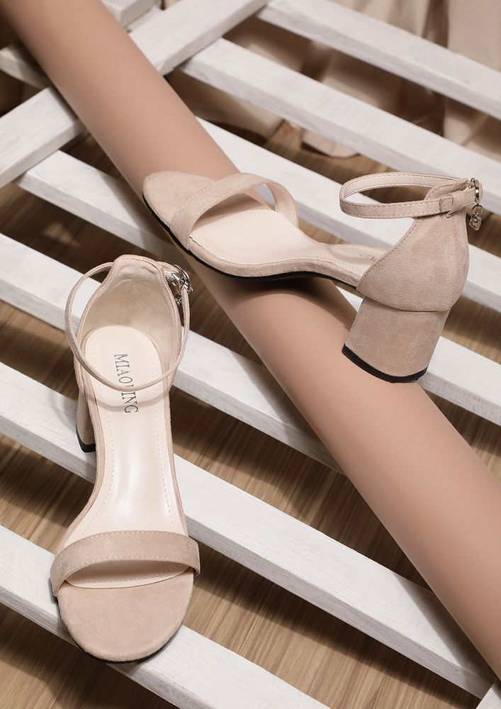 SEEMS LIKE A STAPLE BEIGE HEELED SANDALS