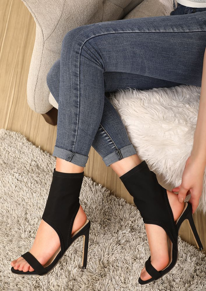 LET'S KEEP THE CUTS BLACK HEELED SANDALS