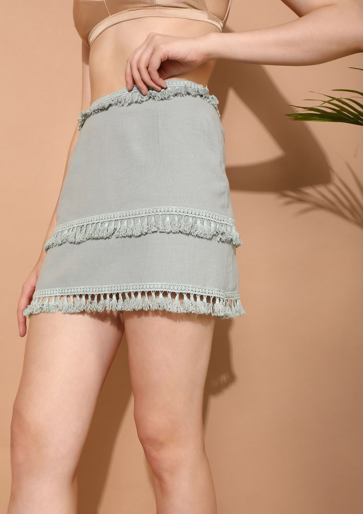 NO HASSLE FOR TASSELS LIGHT GREEN MINI SKIRT