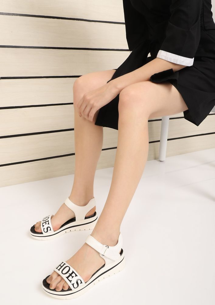 PLAYING IN COMFORT ZONE WHITE FLATFORM SANDALS