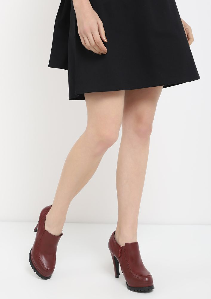 SUBTLE BUT SASSY WINE HEELED BOOTIES