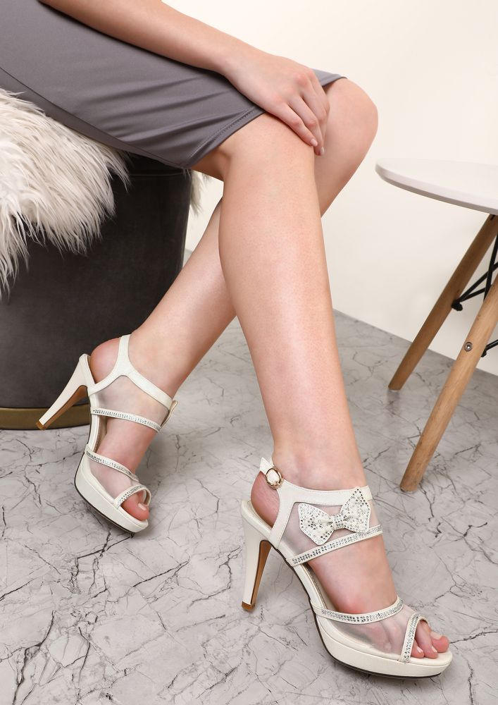 STUNNED BY THE BOW WHITE HEELED SANDALS