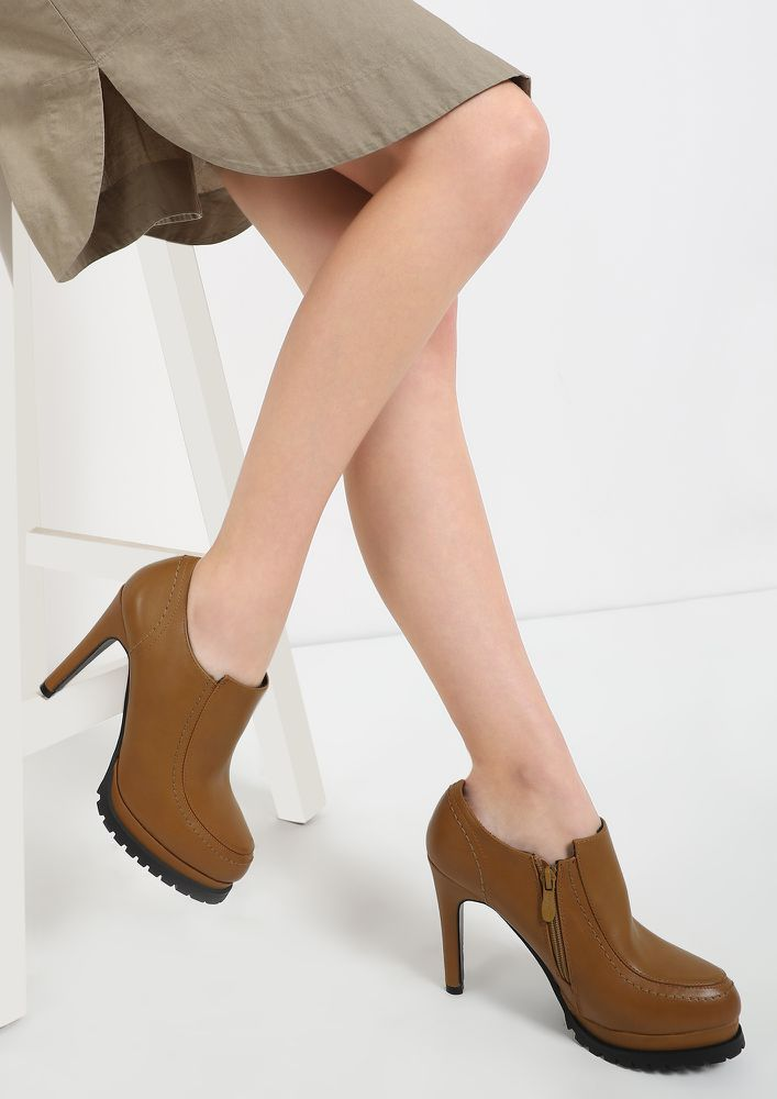 SUBTLE BUT SASSY BROWN HEELED BOOTIES