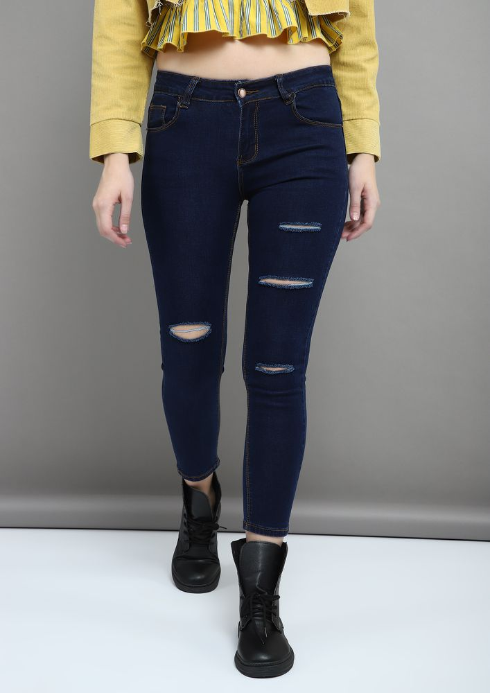 SLITS AND RIPS BLUE RIPPED JEANS