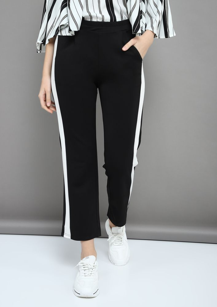 CARED TO FLARE BLACK FLARED TROUSERS