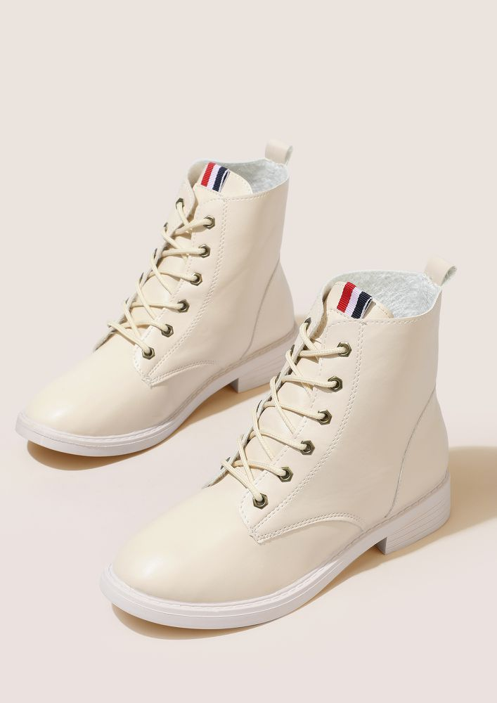 NEAT AND TIDY BEIGE BOOTS