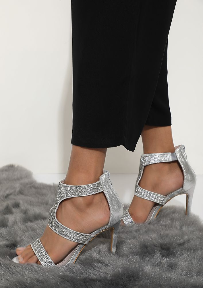STRAPPING YOUR FANTASY SILVER HEELED SANDALS