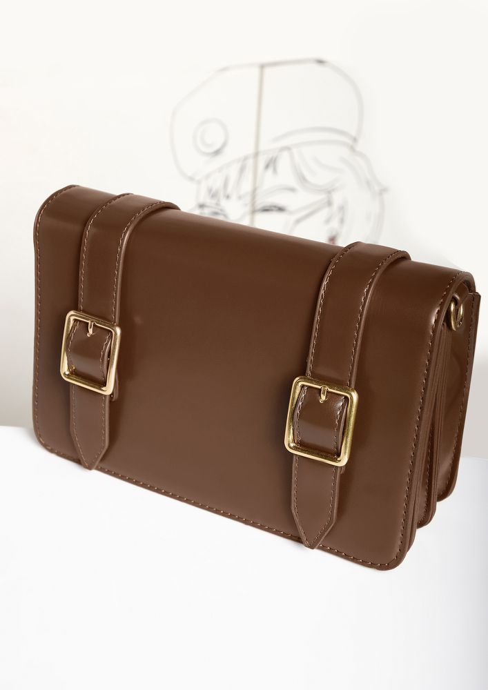 DOUBLE BUCKLED DOWN CARAMEL SLING BAG