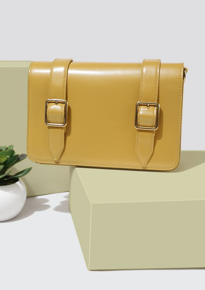 DOUBLE BUCKLED DOWN YELLOW SLING BAG