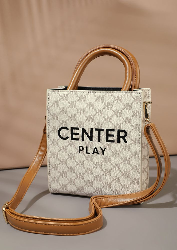 BE IN THE CENTRE PLAY BEIGE BUCKET BAG