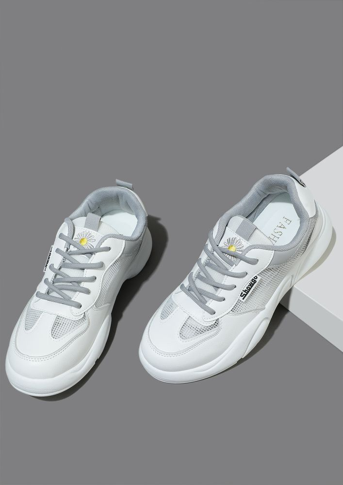 IT'S ALL ABOUT PERFORMANCE GREY TRAINERS
