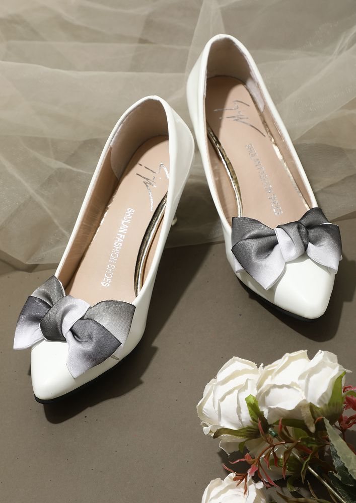 SHOES HAVE SPOKEN WHITE HEELED SANDALS