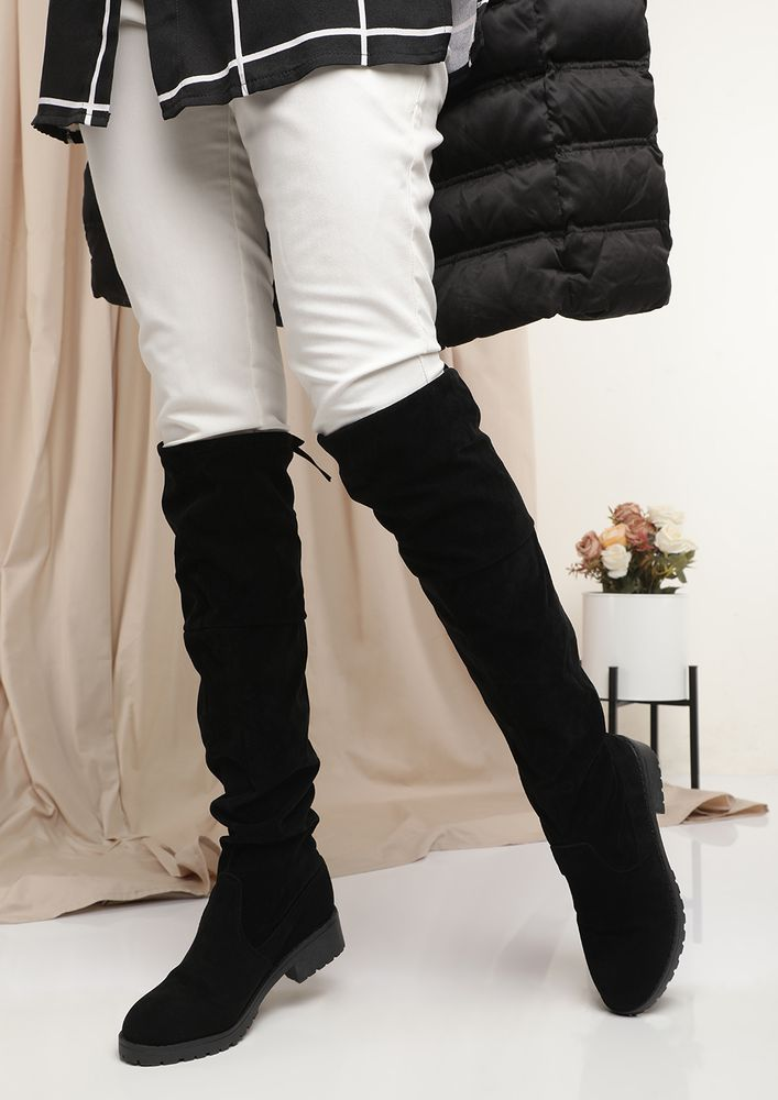 CARRYING COZY VIBES ALONG BLACK THIGH-HIGH BOOTS