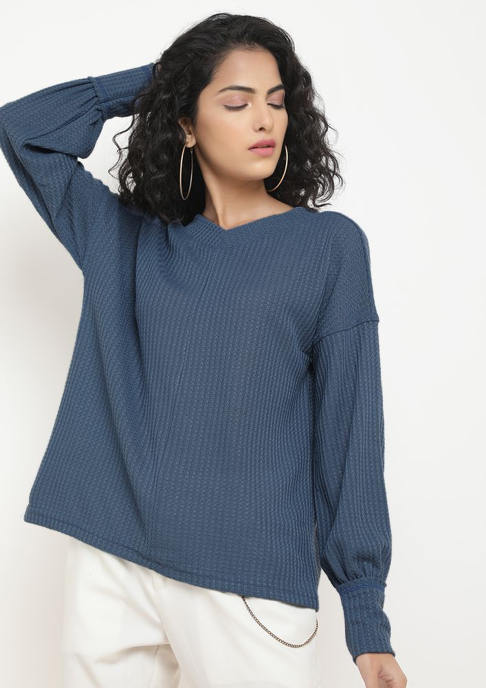 SNUGGLING IN BLUE JUMPER