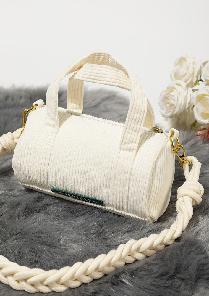 ROLL ABOUT THE WHITE DUFFLE