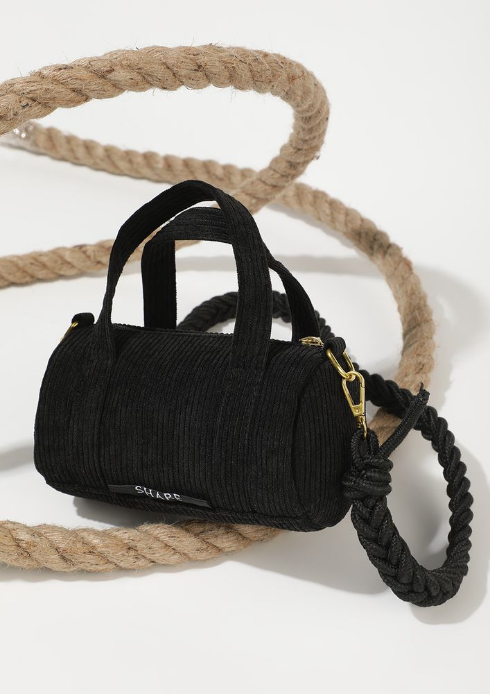 ROLL ABOUT THE BLACK DUFFLE
