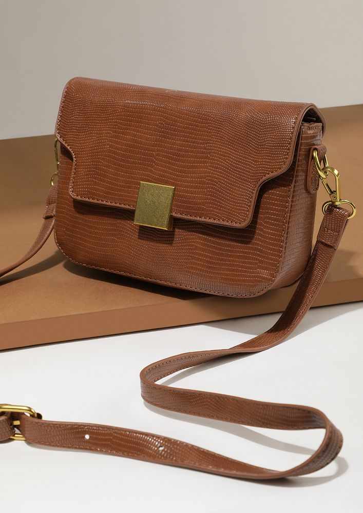 TAKING THE LEAD BROWN SLING BAG