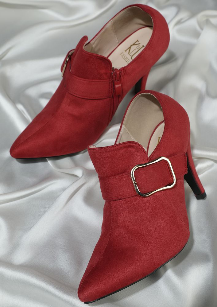 OFFICIALLY TEMPTING RED HEELED SHOES