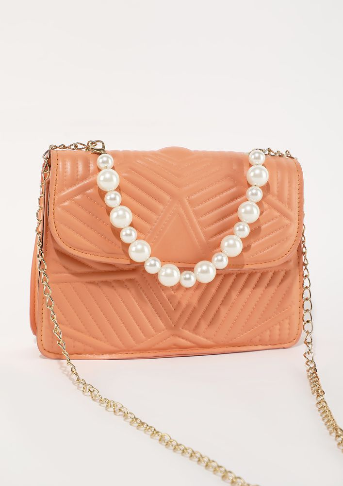 LOVE IS IN A SMALL SIZE ORANGE SLING BAG