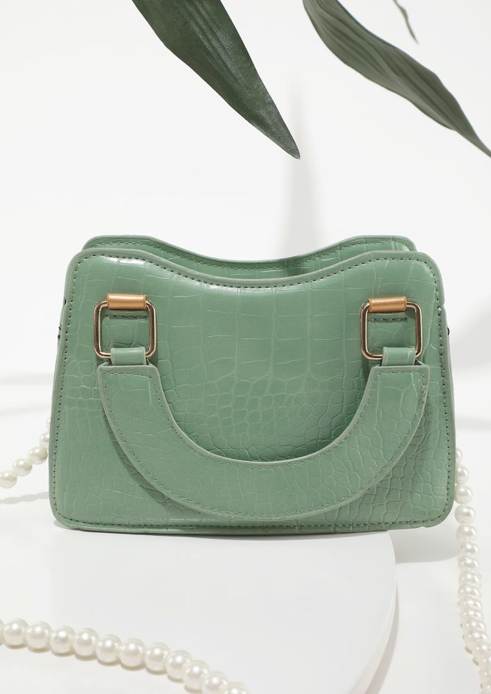 TINY BUT MIGHTY GREEN SLING BAG