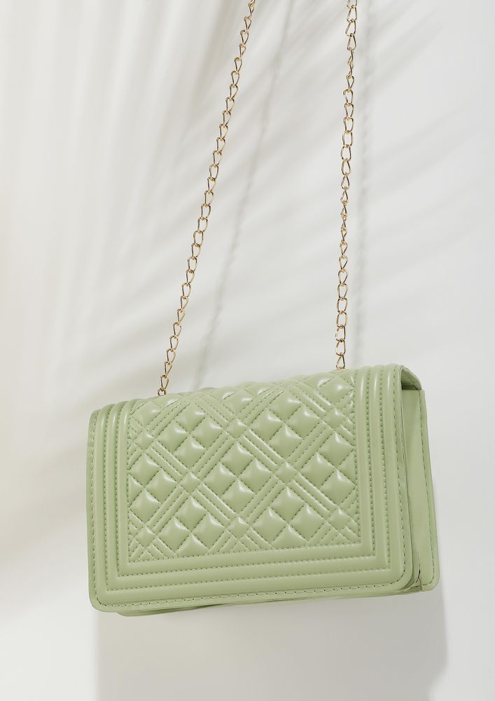TAKE YOUR OWN SWEET TIME GREEN SLING BAG