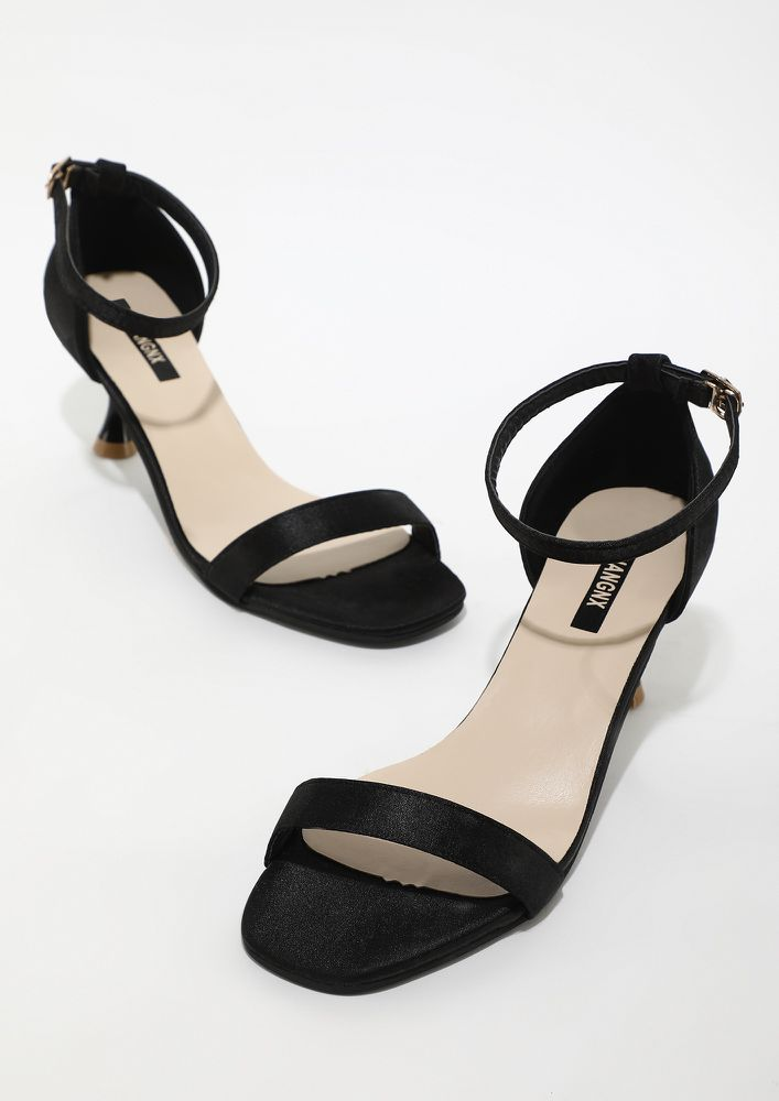 CONQUER THE WORLD WITH A CLICK BLACK HEELS
