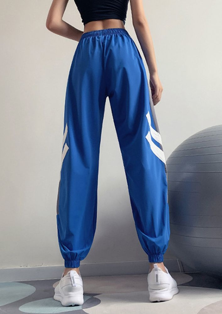 THERE SHE GOES LOOKING LIKE A STAR BLUE TROUSERS