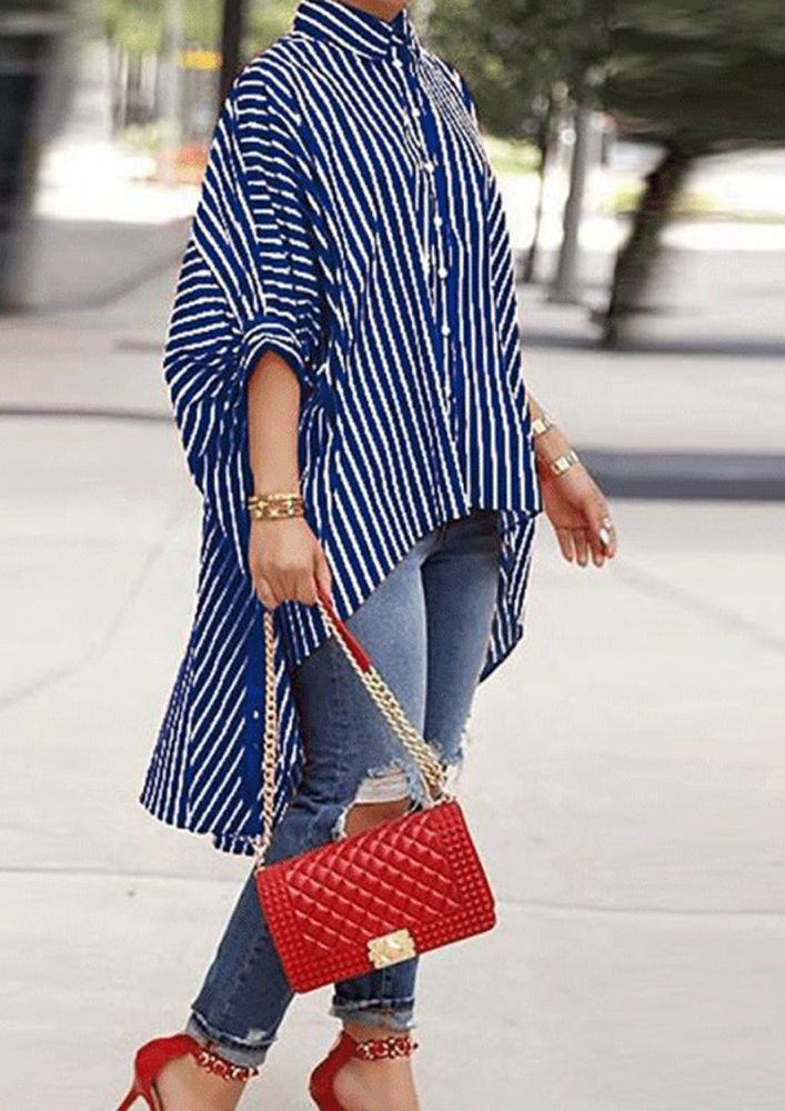 LINED IN A PONCHO BLUE SHIRT