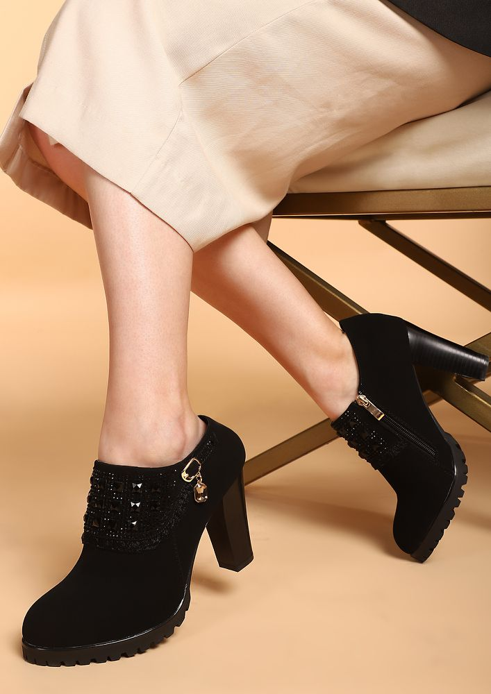 SUITED AND BOOTED BLACK HEELED SHOES